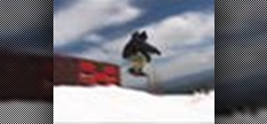 Tailslide a rail on a snowboard