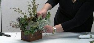 Make a natural floral arrangement in a cigar box