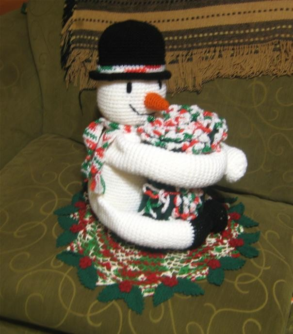 my huggy snowman i made last dec 2009 & the doily