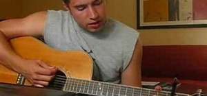 "Play ""Viva La Vida"" by Coldplay on acoustic guitar"