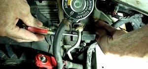 Replace a coolant level sensor on a Chevy Impala