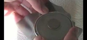 Perform a coin penetration magic trick