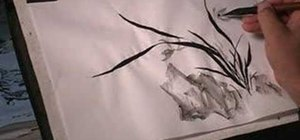 Draw an orchid in Sumi-e Chinese brush painting