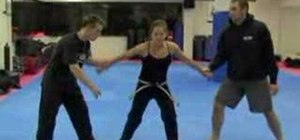 Perform the double wrist grab release for self-defense