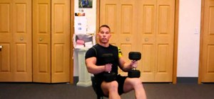 Do a seated dumbbell press to tone shoulders and deltoids
