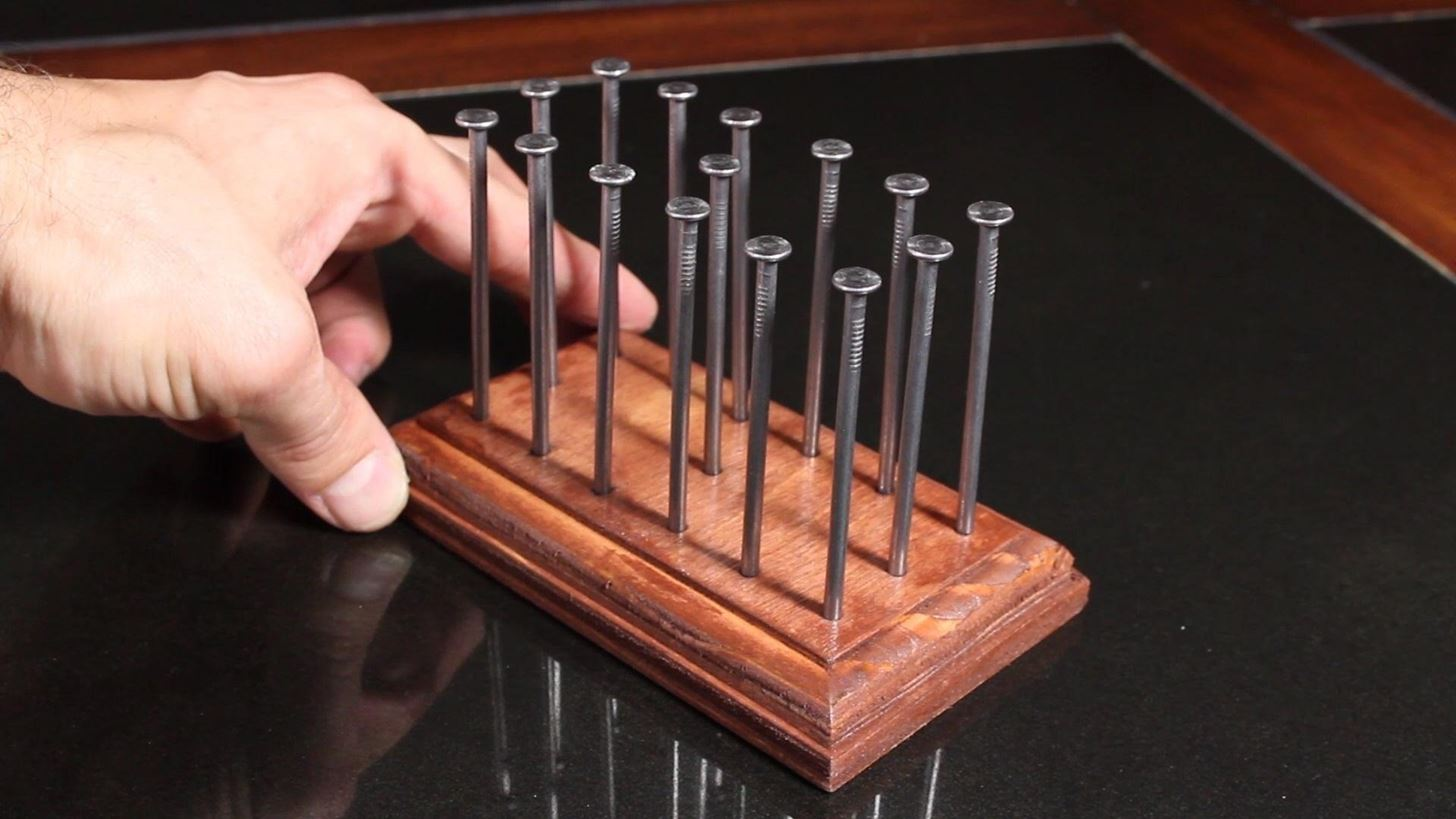 How Do You Balance 14 Nails On A Single Nailhead Find Out With This