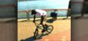 Perform a 180 G-turn on a BMX bicycle