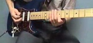 Play a Em7add13 funk chord groove on the guitar