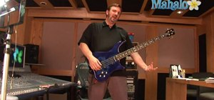 Properly hold an electric bass guitar