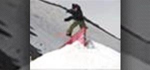 Boardslide a rail on a snowboard