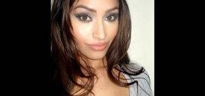 Apply a shimmery blue & silver smokey eye look inspired by Kim Kardashian