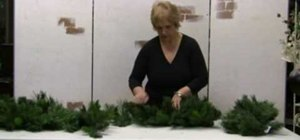 Fluff fake Christmas garlands, wreaths, and sprays to make them look real