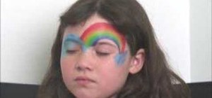 Apply rainbow face paint