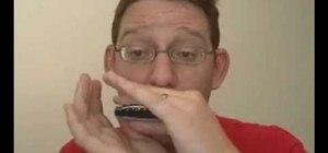 Play blues licks on harmonica