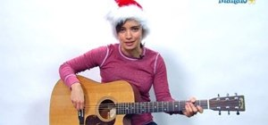 "Play ""Winter Wonderland"" on the acoustic guitar for Christmas"