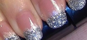 Apply a silver glitter French manicure for parties