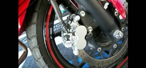 Change the front brake pads on a motorcycle