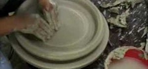 Throw a large ceramic platter on a pottery wheel