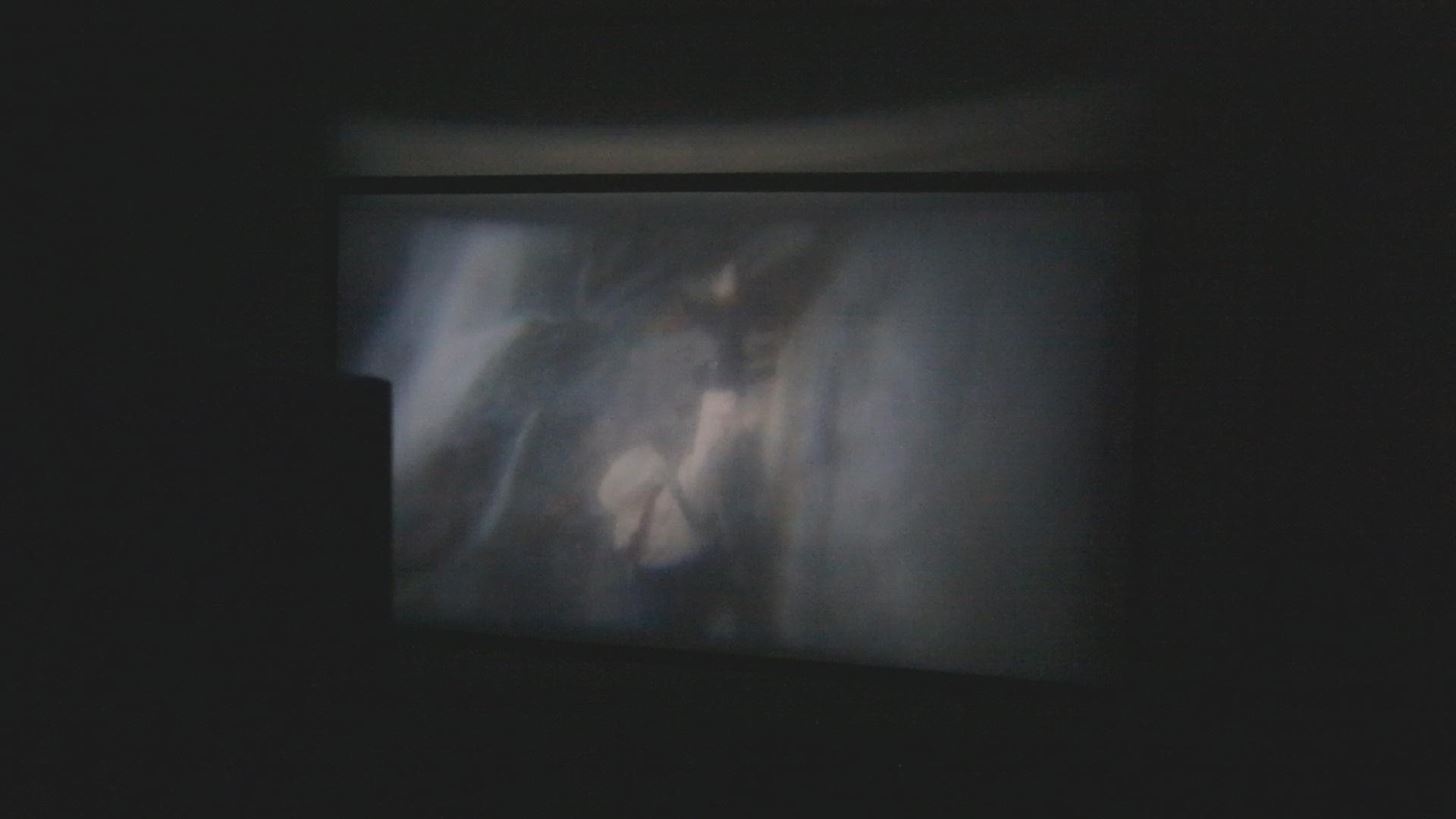 """How to Make a DIY Home Theater Projector and 50"""" Screen for Only $5 (Great for March Madness!)"""