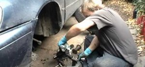 Install new axle bearings on a front wheel drive car