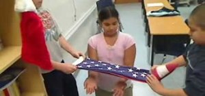 Fold an American flag in the traditional method