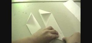 Fold a ninja star (shuriken) out of paper