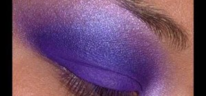 Apply dark purple eye makeup with green liner