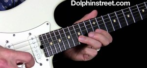 Play a short, repeating blues lick in the key of E