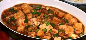 Make Sichuan mapo tofu with pork, garlic, and ginger