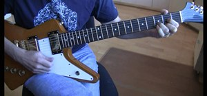 "Play ""Beautiful Day"" by U2 on the electric guitar"