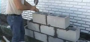 Lay bricks with joint spacers