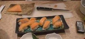 Prepare a salmon roll sushi appetizer