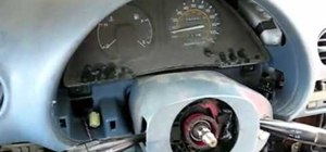 Remove the dashboard and wheel to replace bulbs