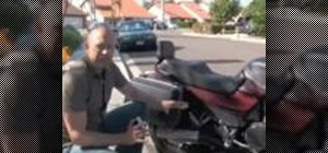 Inspect a motorcycle for damage after an accident