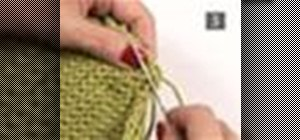 Sew seams together on a knitted garment