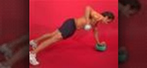 Exercise 1 arm dumbbell plank row on medicine ball