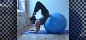 Use a medicine ball for a yoga forearm stand