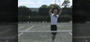Hit an overhead shot in tennis