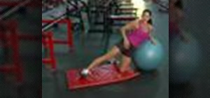 Use a Swiss ball to do outer thigh lifts