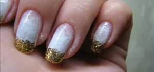 Apply a diffused French manicure with gold sparkles