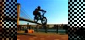 Perform a bunny hop on a BMX bicycle