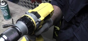 Use a cordless drill and taper tap to cut a threaded hole in steel