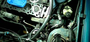 Replace the water pump and timing belt on a Ford Escort automobile