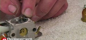 Clean a 2 cycle engine carburetor from a Ryobi trimmer
