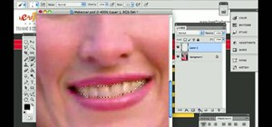 Brighten teeth when touching up a photo in Adobe Photoshop CS5