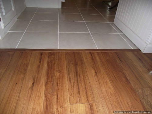 Installing laminate tile over ceramic tile diy laminate floors wonderhowto How to install laminate flooring in a bathroom