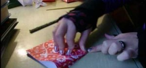 Make a gift box from folded paper with origami