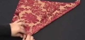 Fold an origami candle napkin design