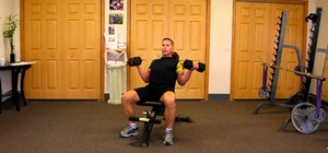 Do seated dumbbell curls to tone arms and biceps
