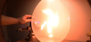 Use a laser to ignite a fire within a regular balloon